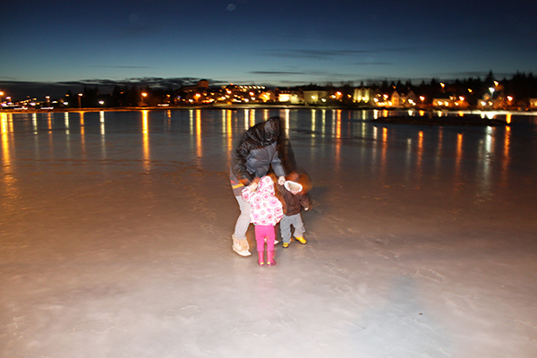 Ice skating, tjorin pond, reykjavik, iceland, city center, ice, snow, diapersonaplane, diapers on a plane, traveling with kids, family travel, creating family memories