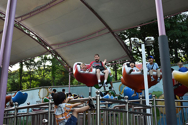 Fun Rides Baby playing with brown bears at Everland in South Korea