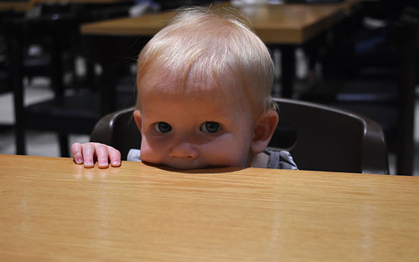 Baby eating the table